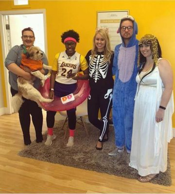 Team dressed up in costumes for halloween